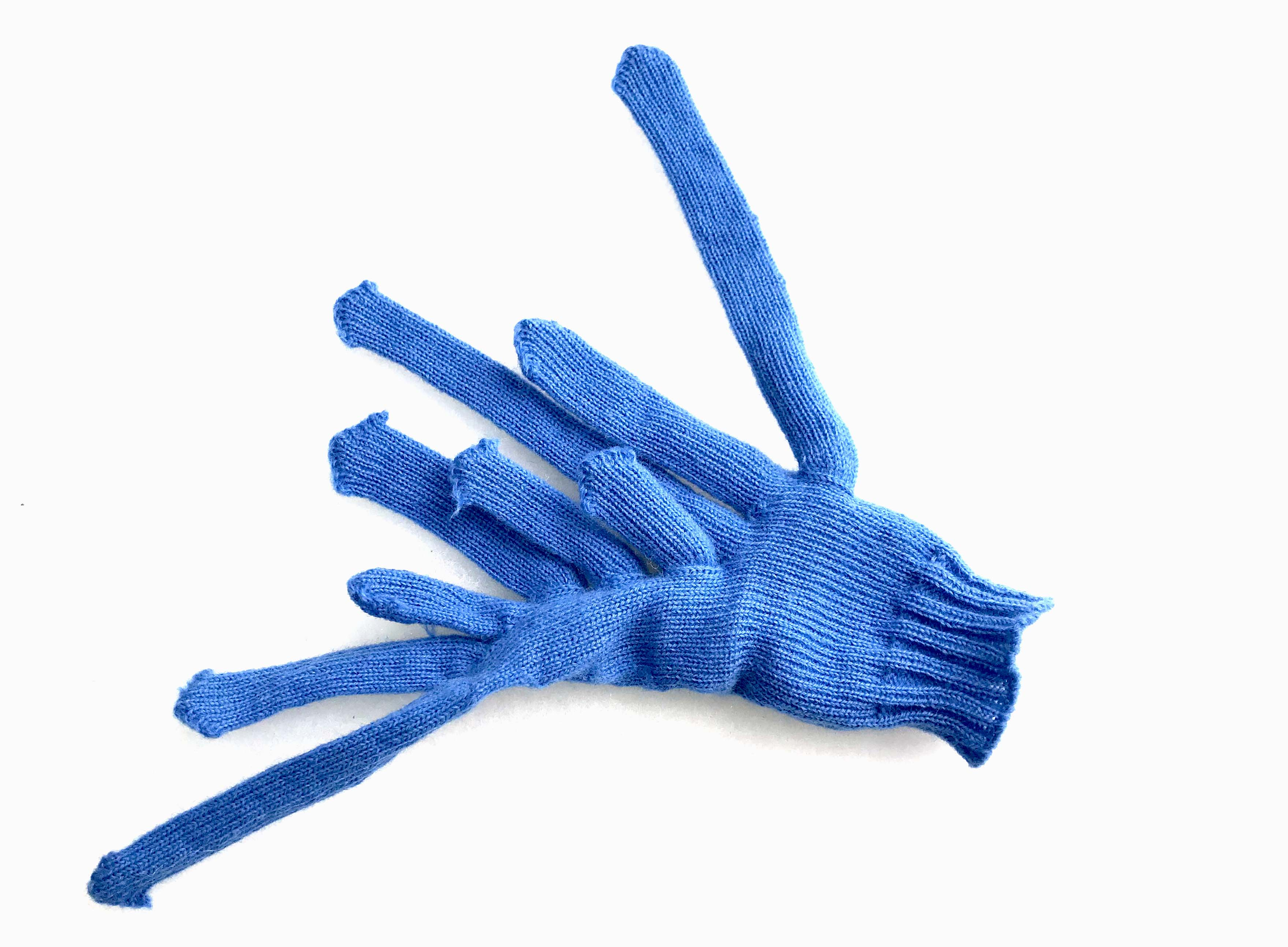 Another glove with slightly too many fingers and thumbs.